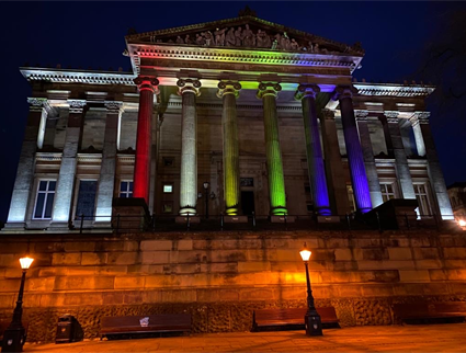 The Harris Museum lit up with Pride flag colours